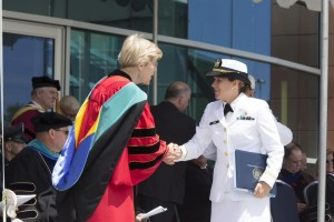 Sarah shakes the hand of Sen. Elizabeth Warren after her graduation as salutatorian of the Class of 2015 and Summa Cum Laude with an engineering degree from Massachusetts Maritime Academy.