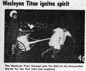 Tommy being pulled onto the field in a chariot.