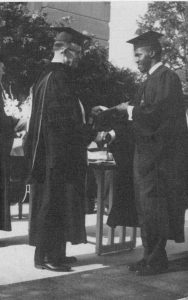 Luther Bedford receiving diplomma from President Eckley in 1959