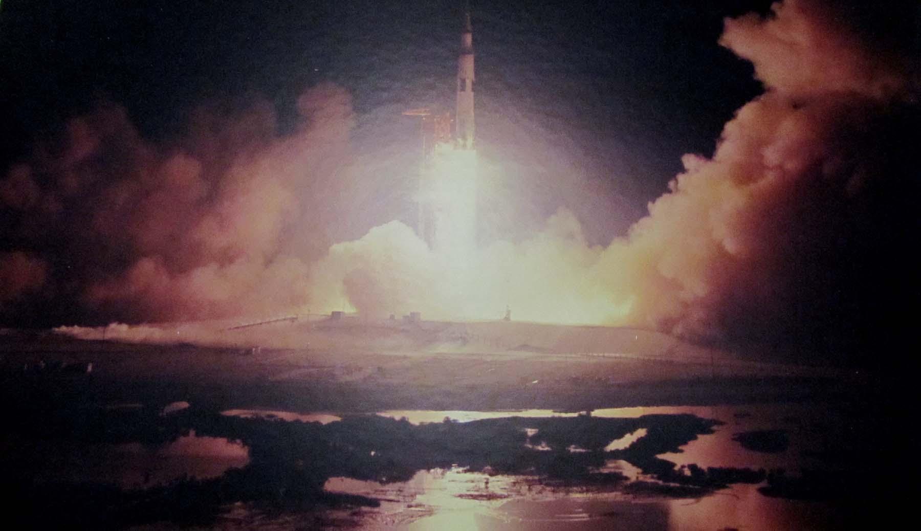 A rocket blasts off at night