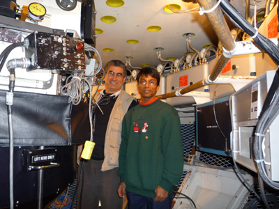 Kundan Chaudhary and Observer Support Specialist Hernan Tirado inside the 4-meter telescope.