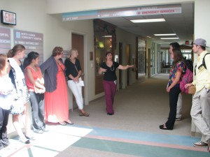 Lokenani Kealoha Souza, a nurse practitioner with the Native Hawaiian Health Clinic at the hospital, describes how she works with clients. This picture also shows the wide hallways in the hospital, as well as the abundance of natural light in the building.