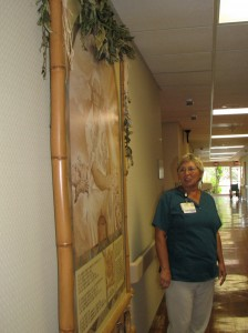 Jennifer Rabalais, part of the holistic care team at NHCH, explains one of the many pieces of art that adorn the halls.