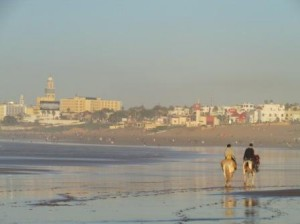 Sun sets on the Casablanca beach. The tower on the left is the Hassan II Mosque, which you can see from anywhere in the city.