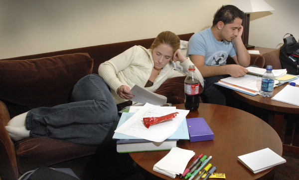 Nursing students, Jenna Kyhl and Giovani Rodriguez, both seniors, put in some serious study for finals in Ames Library, 2000.